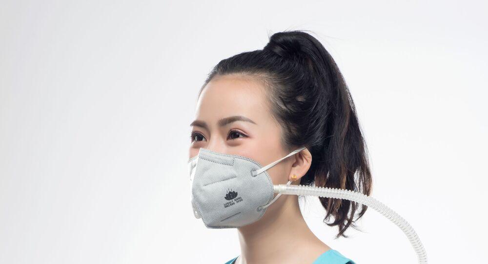 Čínští vědci vyvíjejí elektrostatické antivirové roušky