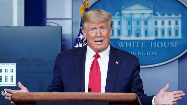 Americký prezident Donald Trump v Bílém domě - Sputnik Česká republika