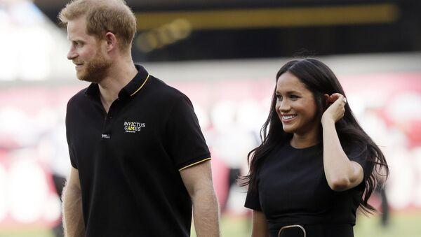 Meghan Markle a princ Harry před baseballovou hrou v Londýně. - Sputnik Česká republika