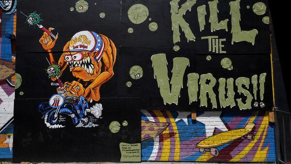 Graffiti na zdi uzavřené restaurace Evel Pieve v Las Vegasu - Sputnik Česká republika