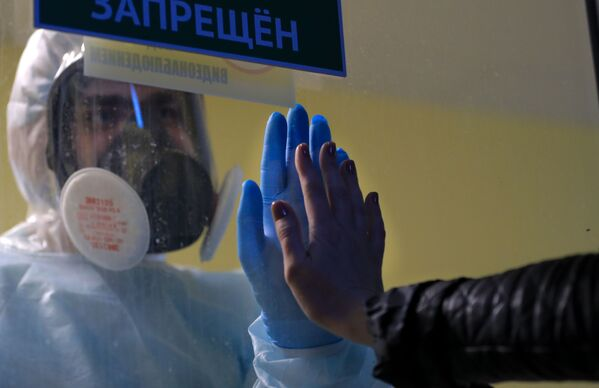 Pandemie život nezastaví. Týden ve fotografiích z celého světa to potvrdil - Sputnik Česká republika