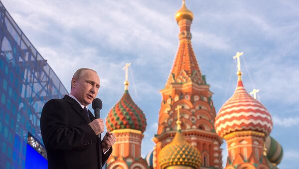 Ruský prezident Vladimir Putin na mítinku věnovaném připojení Krymu k Rusku - Sputnik Česká republika