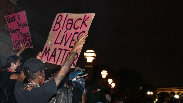 Účastníci protestu Black Lives Matter - Sputnik Česká republika