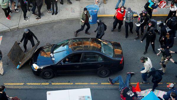V Seattlu do demonstrantů vjelo auto - Sputnik Česká republika