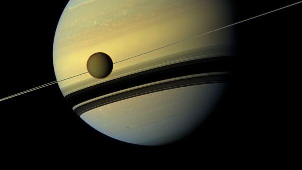 Saturn a jeho největší družice Titan - Sputnik Česká republika