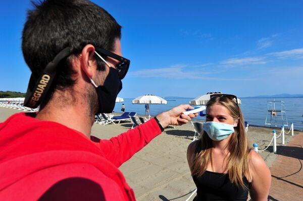 Měření teploty na pláži Punta Hidalgo v Itálii. - Sputnik Česká republika