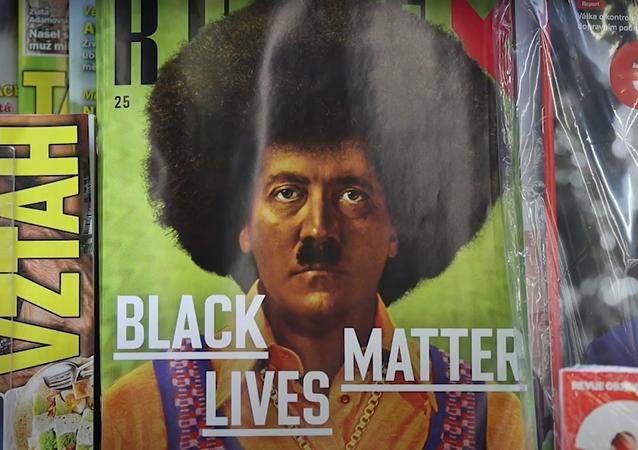 """""""V USA by vám zapálili redakci."""" Hitler jako černoch na obálce časopisu Reflex vyvolal rozporuplnou reakci"""