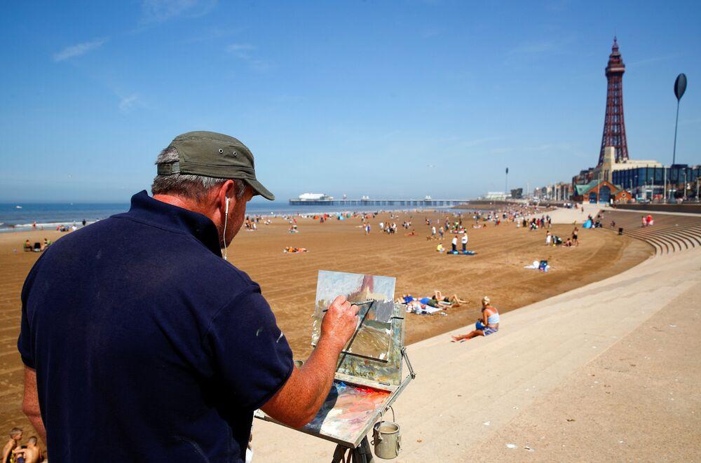 Umělec maluje v Blackpoolu, Velká Británie