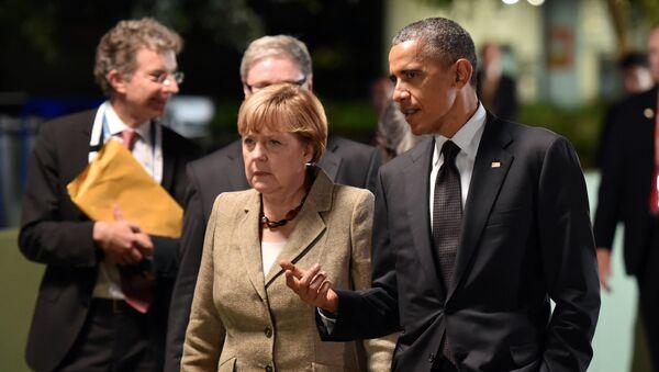 President Obama and Chancellor Merkel at the G20 Summit in November. - Sputnik Česká republika