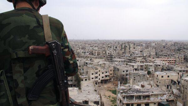 Syrský voják v Homsu - Sputnik Česká republika