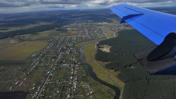 Pohled z okna letadla - Sputnik Česká republika
