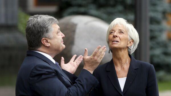 Ukrajinský prezident Petro Porošenko a Šéfka MMF Christine Lagardeová - Sputnik Česká republika