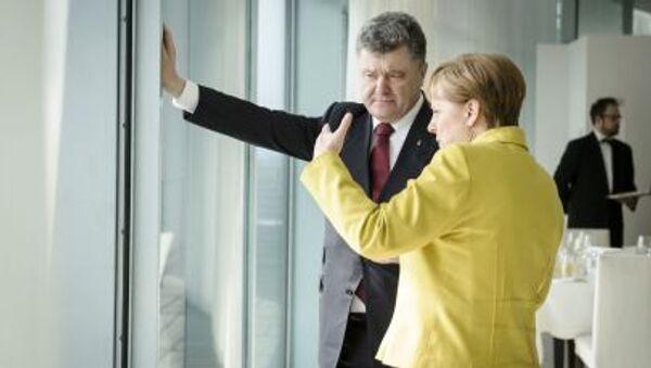 Angela Merkelová a Petro Porošenko - Sputnik Česká republika