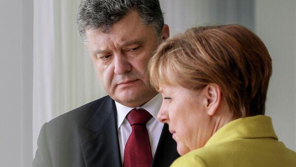 Ukrajinský prezident Petro Porošenko a německá kancléřka Angela Merkelová - Sputnik Česká republika