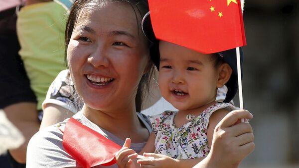 Číňanka s dítětem - Sputnik Česká republika