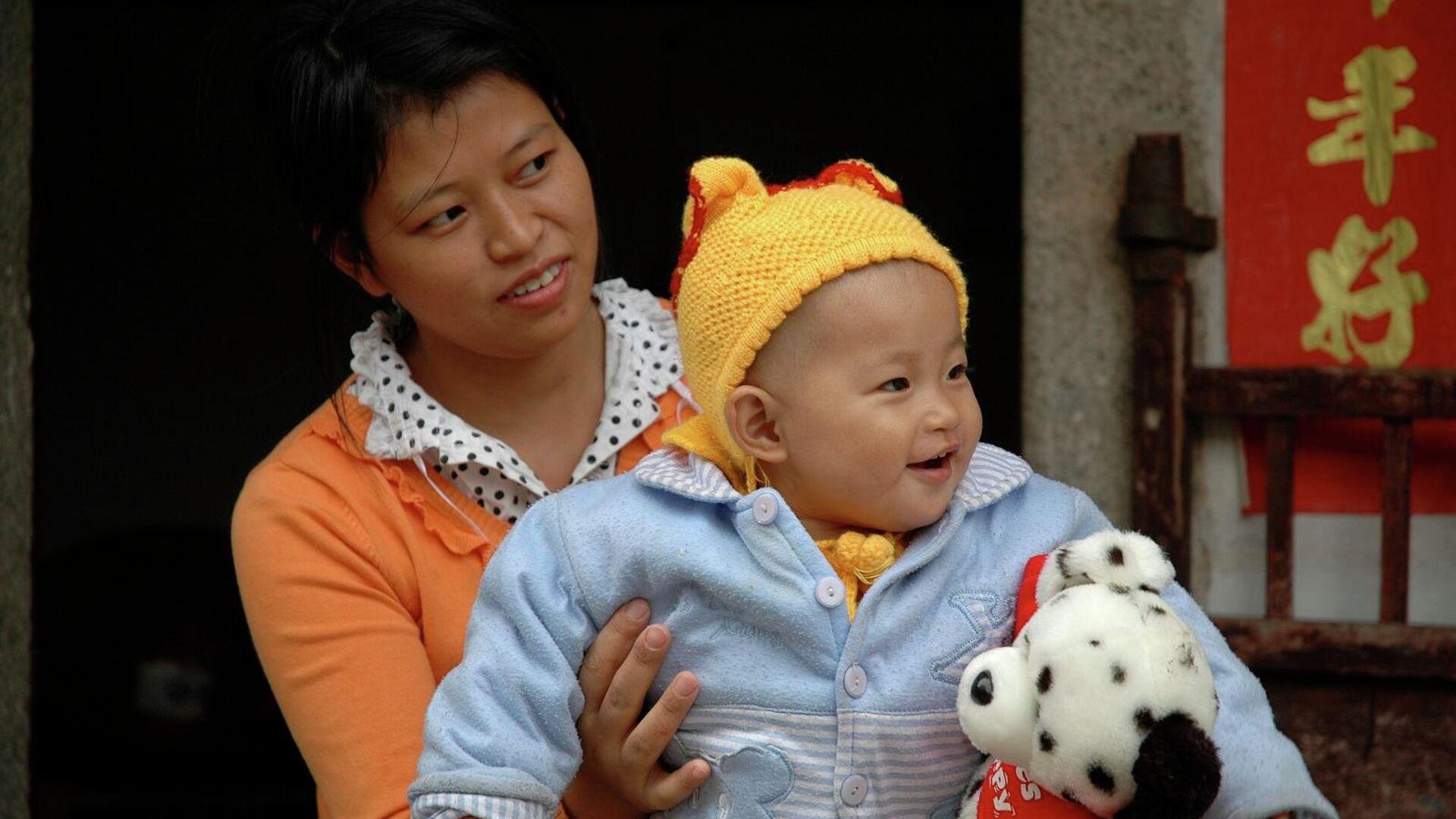 Číňanka s dítětem - Sputnik Česká republika, 1920, 20.07.2021