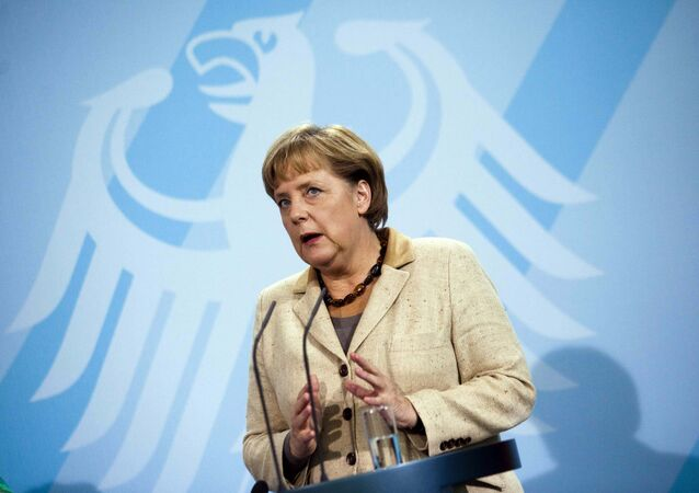 German Chancellor Angela Merkel  in front of Germany's heraldic eagle