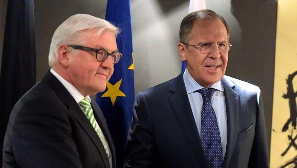 Frank Walter Steinmeier a Sergej Lavrov - Sputnik Česká republika