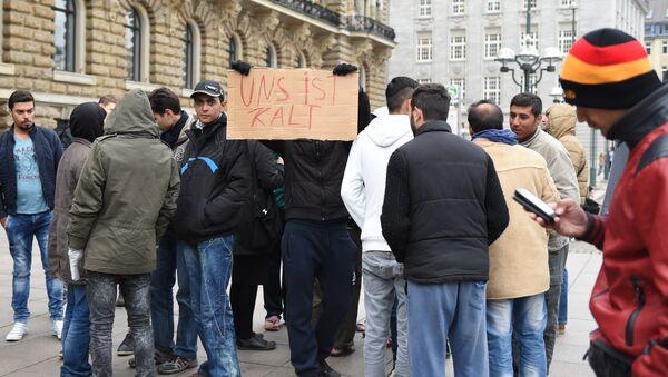Migranti v Hamburku - Sputnik Česká republika