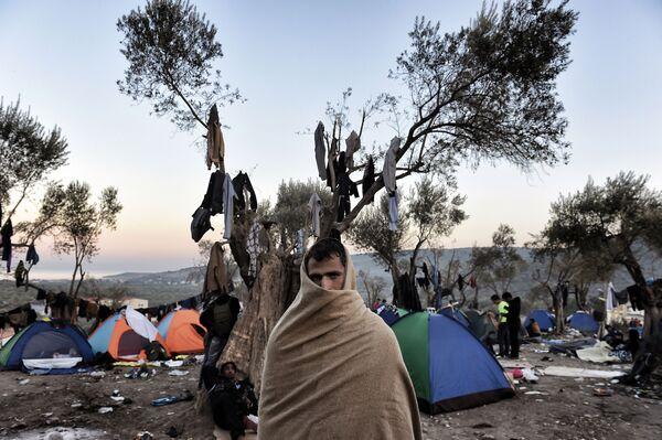 Uprchlík na řeckém ostrově Lesbos - Sputnik Česká republika