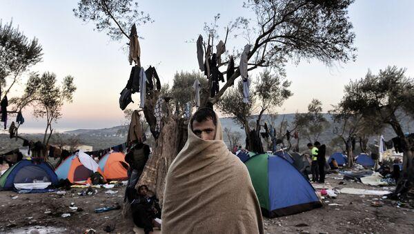 Uprchlík na řeckém ostrově Lesbos. - Sputnik Česká republika
