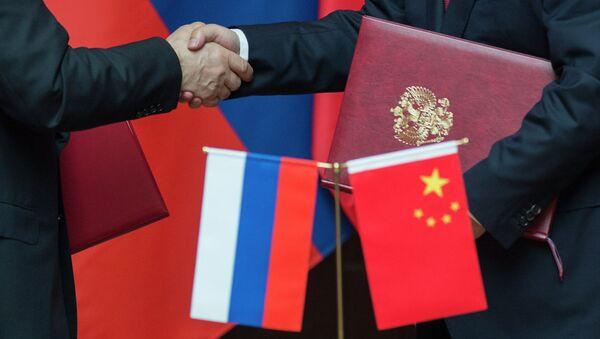 Čínská a ruská vlajky - Sputnik Česká republika