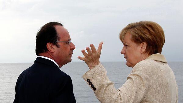 Angela Merkelová a Francois Hollande - Sputnik Česká republika