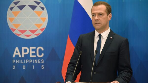 Ruský premiér Dmitrij Medveděv na summitu APEC - Sputnik Česká republika