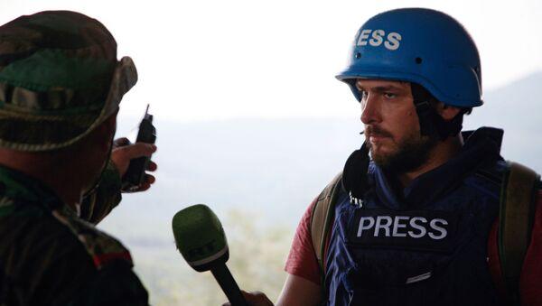 Korespondent RT Sargon Hadaja - Sputnik Česká republika
