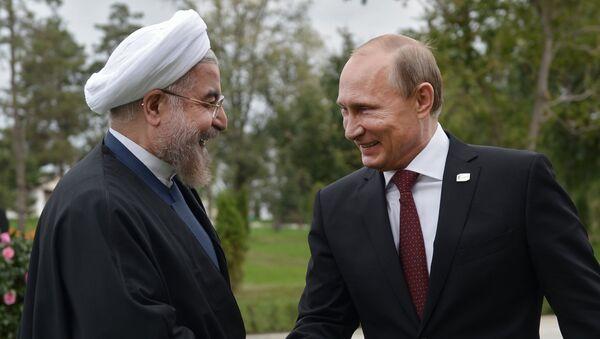 Iranský prezident Hassan Rouhani a ruský prezident Vladimir Putin - Sputnik Česká republika