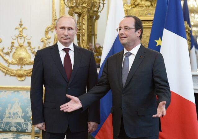 Vladimir Putin a Francois Hollande