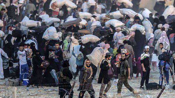 Syrští běženci na syrsko-turecké hranici - Sputnik Česká republika
