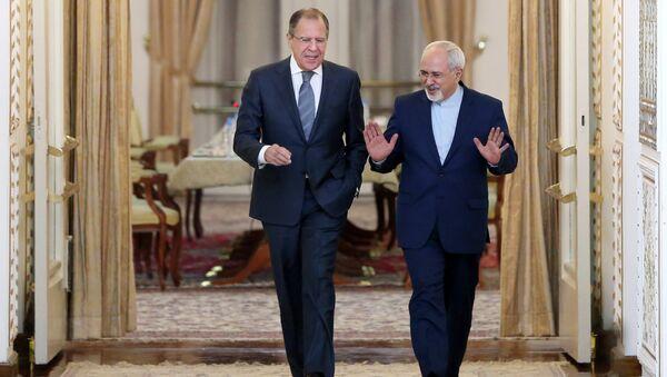 Šéfové diplomacií Ruska a Íránu Sergej Lavrov a Mohammad Džavád Zaríf - Sputnik Česká republika