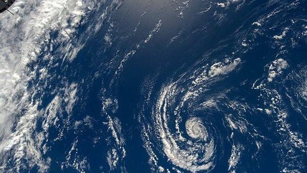 Nad oceánem a mraky. Ilustrační foto - Sputnik Česká republika