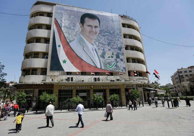 Portrét Bašára Asada v Damašku