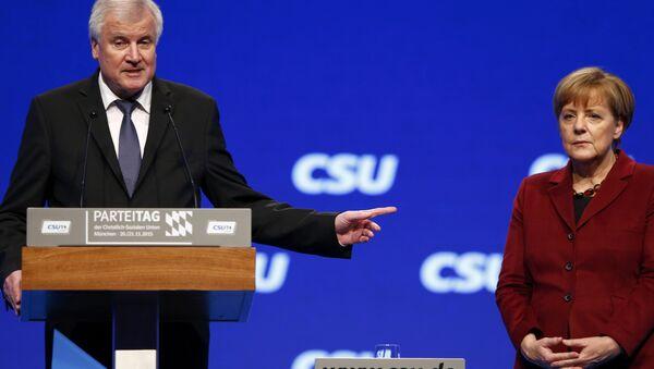 Premiér Bavorska Horst Seehofer a Angela Merkelová - Sputnik Česká republika