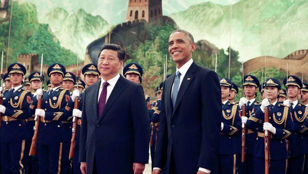 Americký prezident Barack Obama a čínský prezident Si Ťin-pching - Sputnik Česká republika
