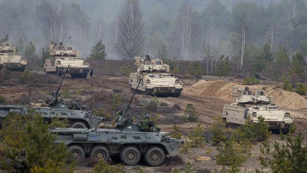 Cvičení NATO Iron Sword 2014 v Litvě - Sputnik Česká republika