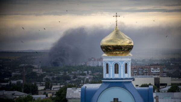 Bombardování osídlených čtvrtí Luhanska. Archivní foto - Sputnik Česká republika