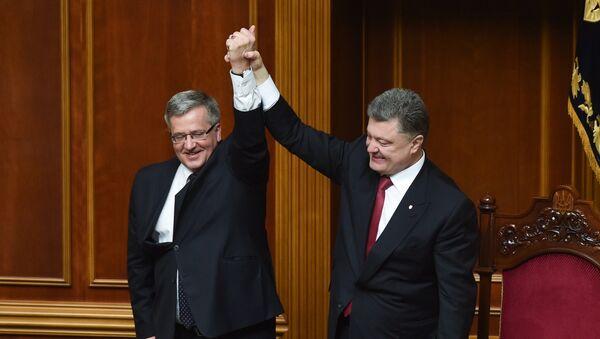 Polský prezident Bronisław Komorowski a ukrajinský prezident Petro Porošenko - Sputnik Česká republika