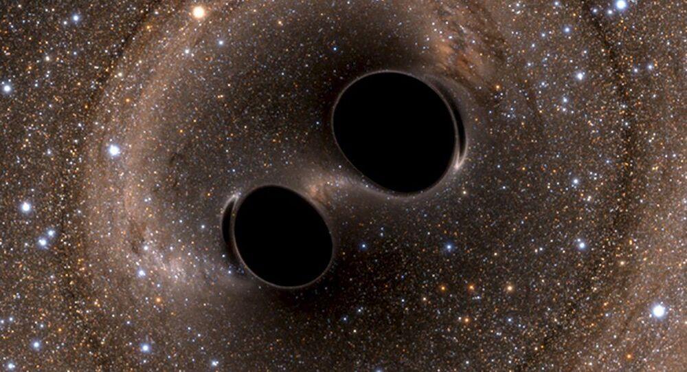 Gravitační vlny dvou černých děr. Ilustrační foto