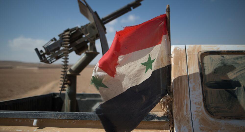 Syrská vlajka a kulomet
