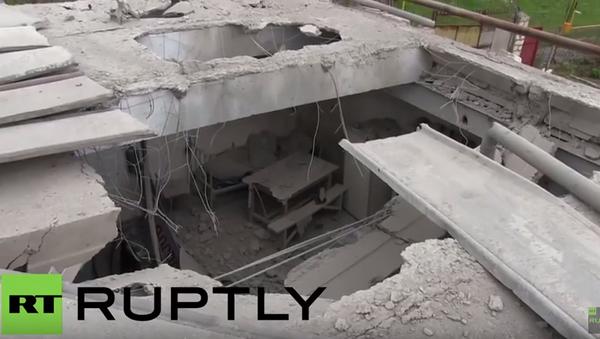 Následky ostřelování v obytné čtvrti a na vojenské základně v Náhorním Karabachu - Sputnik Česká republika
