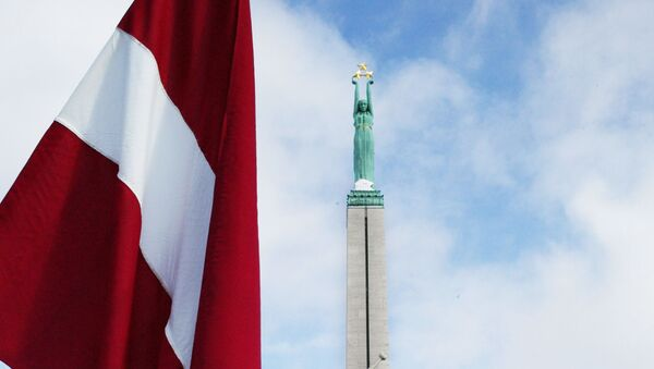 Lotyšská vlajka v Rize - Sputnik Česká republika