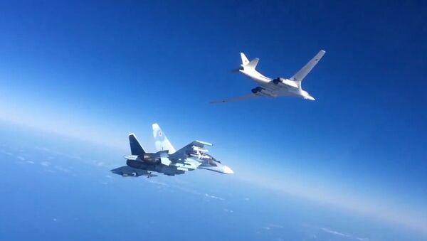 Tu-160 se stíhacím doprovodem v Sýrii. Ilustrační foto - Sputnik Česká republika