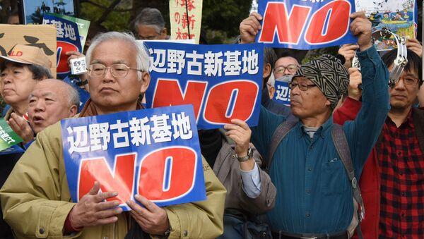 Protestní akce v Tokiu, archivní foto - Sputnik Česká republika