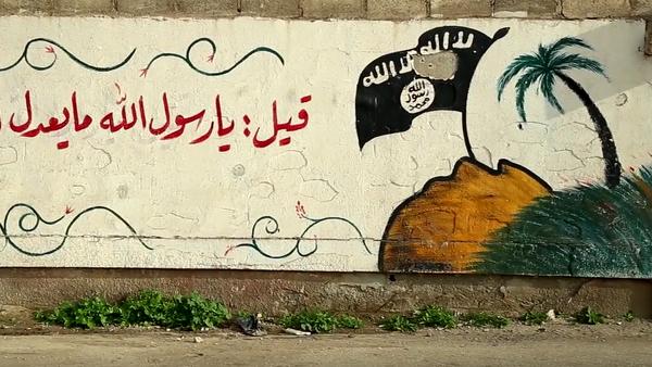 Graffiti s vlajkou IS - Sputnik Česká republika
