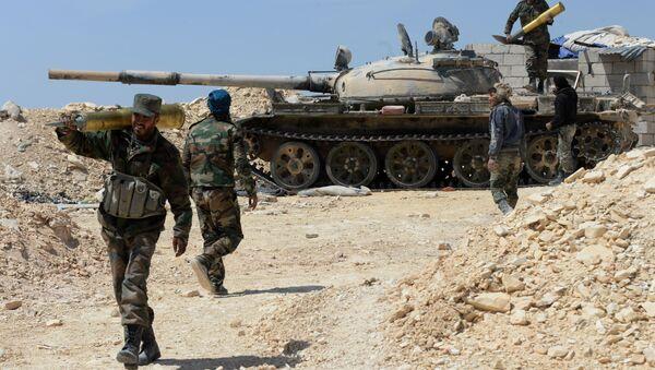 Syrští bojovníci během ofenzivy - Sputnik Česká republika