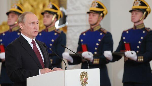 Vladimir Putin během předání státních vyznamenání - Sputnik Česká republika
