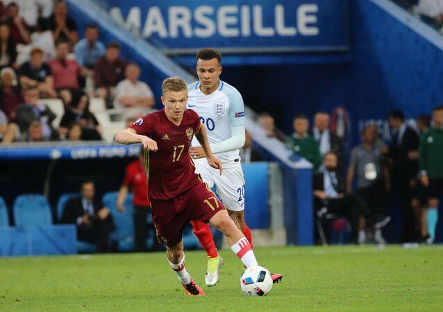 Ruský a anglický fotbalisté